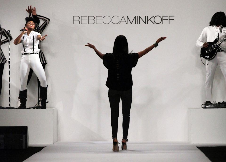 Designer Rebecca Minkoff acknowledges singer Janelle Monae, left, after she performed during the showing of Minkoff's Spring Summer 2014 collection at New York Fashion Week on Friday, Sept. 6, 2013 in New York. (AP Photo/Lisa Tolin)