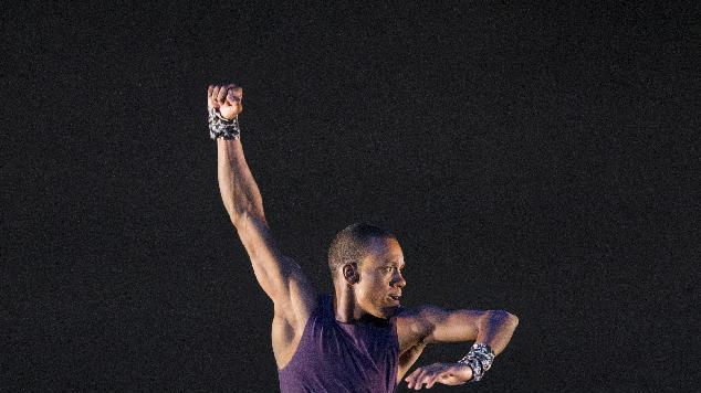 """This publicity image released by Alvin Ailey American Dance Theater shows Kirven James Boyd performing in """"Four Corners, choreographed by Ronald K. Brown, at Lincoln Center's David H. Koch Theater in New York. (AP Photo/Alvin Ailey American Dance Theater, Paul Kolnik)"""