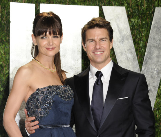 FILE - In this Feb. 26, 2012 file photo, actors Tom Cruise and Katie Holmes arrive at the Vanity Fair Oscar party, in West Hollywood, Calif. Cruise and Holmes have reached an agreement in their divorce case, according to her attorney. Holmes&#39; attorney Jonathan Wolfe said in a statement Monday, July 9, that the case has been settled and an agreement was signed. Holmes filed for divorce less than two weeks ago, putting an end to the romance that began in 2005. The couple has a 6-year-old daughter, Suri. (AP Photo/Evan Agostini, File)