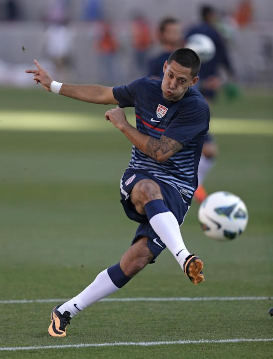 FILE - In this June 18, 2013 file photo, United State's Clint Dempsey takes a shot at goal during warm ups before a World Cup qualifying soccer match against Honduras, at Rio Tinto Stadium in Sand
