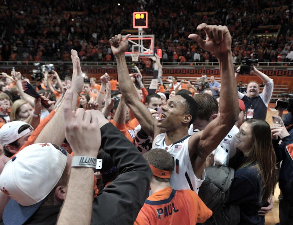 Illinois' Joseph Bertrand celebrates after Illinois defeated No. 1-ranked Indiana in an NCAA college basketball game at Assembly Hall in Champaign, Ill., on Thursday, Feb. 7, 2013. Illinois won 74-72. (AP Photo/John Dixon)