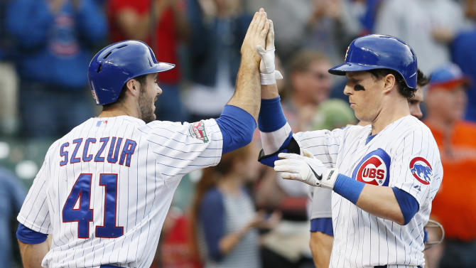 Chicago Cubs' Chris Coghlan, right, celebrates his two-run home run with Matt Szczur, left, during the eighth inning of a baseball game against the Los Angeles Dodgers on Saturday, Sept. 20, 2014, in Chicago. (AP Photo/Andrew A. Nelles)
