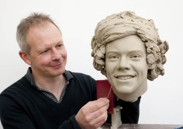 Madame Tussauds, sculptor Jim Kemp works on the clay head of Harry Styles of One Direction. Madame Tussauds announced on March 11, 2013 that the world famous wax attraction will immortalize the band by creating five individual wax figures of each member -- Getty Images