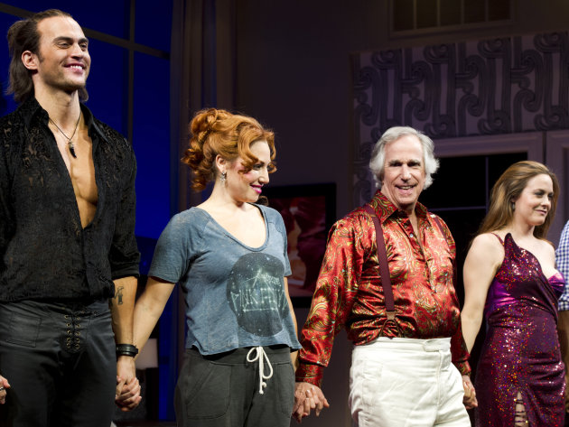 From left, Cheyenne Jackson, Ari Graynor, Henry Winkler and Alicia Silverstone on stage at the curtain call for the opening night performance of the Broadway play, &quot;The Performers,&quot; on Wednesday, Nov. 14, 2012, in New York. (Photo by Charles Sykes/Invision/AP)