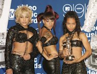 TLC posing with their MTV Video Music Award for Best Group Video for their video &#39;No Scrubs&#39; during the ceremony at the Metropolitan Opera House at the Lincoln Center in New York on September 10, 1999 -- Getty Premium
