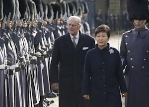 South Korea's President Park Geun-hye is escorted by…