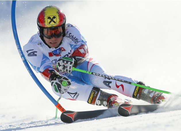 Hirscher of Austria clears a gate during the men's Giant-Slalom race at the Alpine Skiing World Cup finals in Lenzerheide