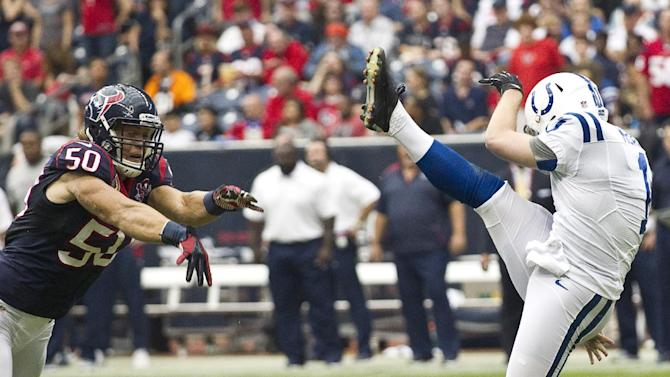 Houston Texans linebacker Bryan Braman (50) blocks a punt by Indianapolis Colts' Pat McAfee (1) in the second quarter of an NFL football game on Sunday, Dec. 16, 2012, in Houston. Braman returned the block for a touchdown (AP Photo/Houston Chronicle, Brett Coomer)  MANDATORY CREDIT