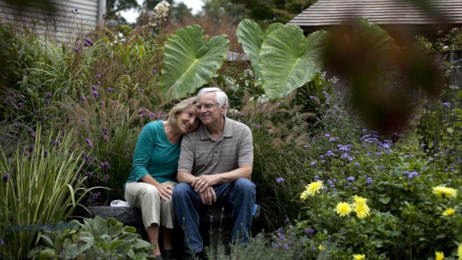 "In this photo taken Oct. 5, 2012, independent voters Thyra and Joe Galli relax in their flower garden, in Portsmouth, N.H. Thyra plans to vote for Obama and Joe is supporting Romney. New Hampshire's nickname is ""the Granite State"" but there's nothing solid about its political landscape. Independent voters have been the reason in recent presidential elections. Today, former factory towns to the south _ Manchester and Nashua _ typically vote Republican as do the rural small towns up north, while state capital Concord and university towns like Durham, Dover, Keene and Hanover tend to lean Democratic. And the entire state is peppered with independents like Joe and Thyra Galli of Portsmouth. (AP Photo/Robert F. Bukaty)"