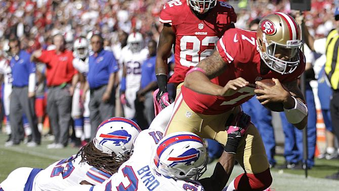 San Francisco 49ers quarterback Colin Kaepernick (7) is tackled by Buffalo Bills safety Jairus Byrd (31) and cornerback Stephon Gilmore during the third quarter of an NFL football game in San Francisco, Sunday, Oct. 7, 2012. (AP Photo/Ben Margot)