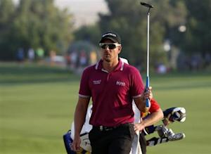 Stenson of Sweden swings his club at 18th hole during the DP World Tour Championship golf tournament in Dubai