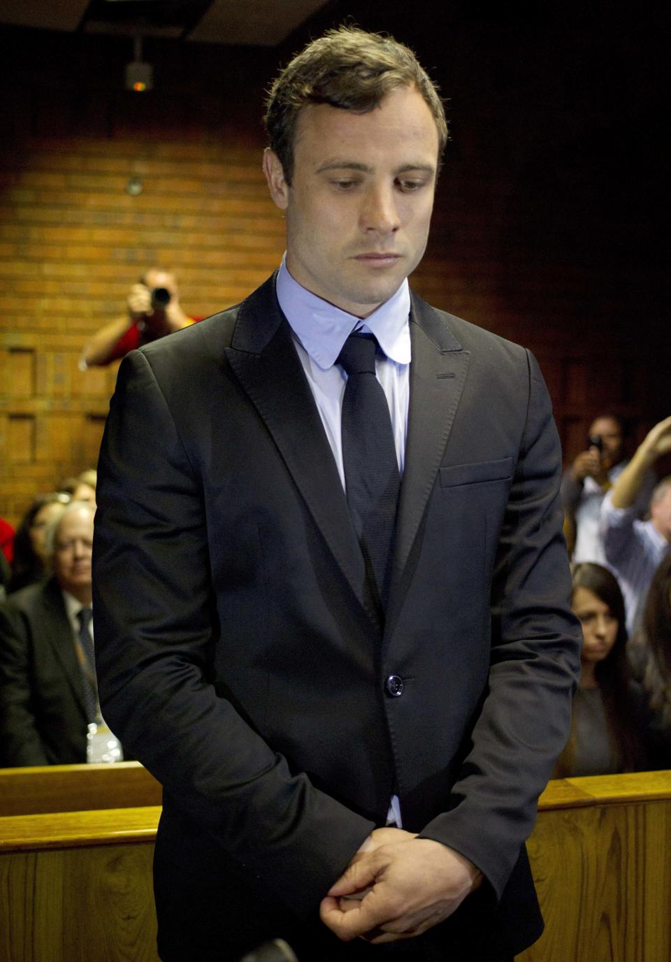 Oscar Pistorius appears at a court in Pretoria, South Africa, Monday, Aug. 19, 2013. Pistorius arrived at the South African court ahead of the expected indictment of the double-amputee Olympian on a premeditated murder charge. (AP Photo/Themba Hadebe)