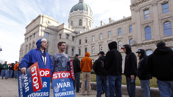 Union members protesting the right-to-work legislation wait to enter the Statehouse in Indianapolis, Wednesday, Feb. 1, 2012. The Senate is hearing the right-to-work bill on final reading and the governor is expected to sign the bill later in the day.  (AP Photo/Michael Conroy)