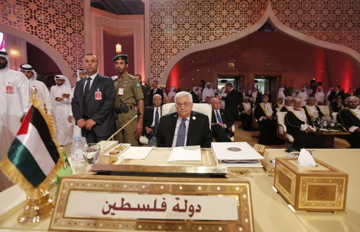Palestinian President Mahmoud Abbas looks on during the opening of the Arab League summit in Doha