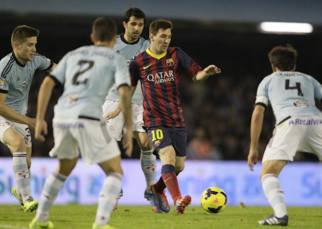 Barcelona's  Lionel Messi from Argentina,  center, in action with unidentified RC Celta players, during a Spanish La Liga soccer match at the Balaidos stadium in Vigo, Spain, Tuesday, Oct. 29, 2013