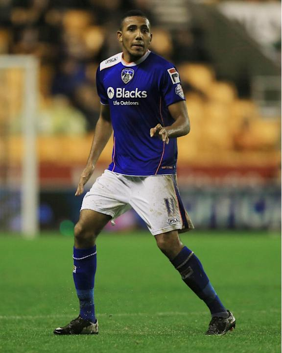 This file photo dated Oct. 22, 2013, shows Oldham Athletic's Cristian Montano. One of the six players arrested as part of an investigation into spot-fixing in English football has been fired by hi