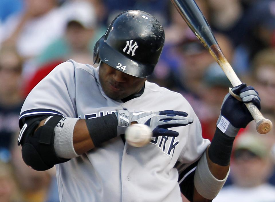 New York Yankees' Robinson Cano is hit by a pitch from Boston Red Sox's Felix Doubront in the first inning of a baseball game in Boston, Saturday, April 21, 2012. (AP Photo/Michael Dwyer)