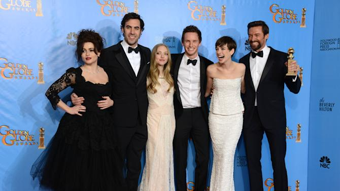 "Actors Helena Bonham Carter, Sacha Baron Cohen, Amanda Seyfried, Eddie Redmayne, Anne Hathaway and Hugh Jackman, from left to right, pose with the award for best motion picture comedy or musical for ""Les Miserables"" backstage at the 70th Annual Golden Globe Awards at the Beverly Hilton Hotel on Sunday Jan. 13, 2013, in Beverly Hills, Calif. (Photo by Jordan Strauss/Invision/AP)"
