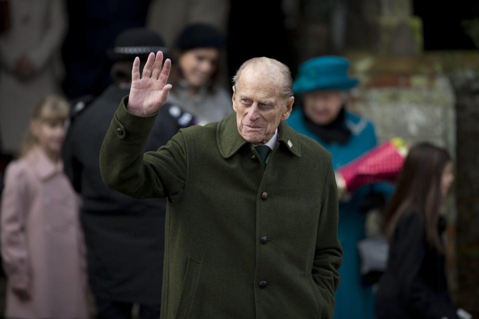 The husband of Britain's Queen Elizabeth II, Prince Philip waves as he leaves after attending the British royal family's traditional Christmas Day church service in Sandringham, England, Tuesday, Dec. 25, 2012.  (AP Photo/Matt Dunham)
