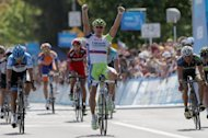 Slovakia&#39;s Peter Sagan celebrate his victory as Australia&#39;s Heinrich Haussler (L) finishes second and American Fred Rodriguez (R) finishes third in stage one of the Amgen Tour of California on May 13
