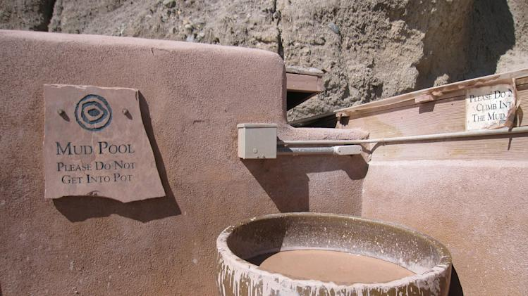 This October 2012 photo of  a mud bath at Ojo Caliente, a natural hot springs attraction in New Mexico. The site includes a hotel and restaurant in addition to mineral springs, and a variety of pools. (AP Photo/Beth Harpaz)