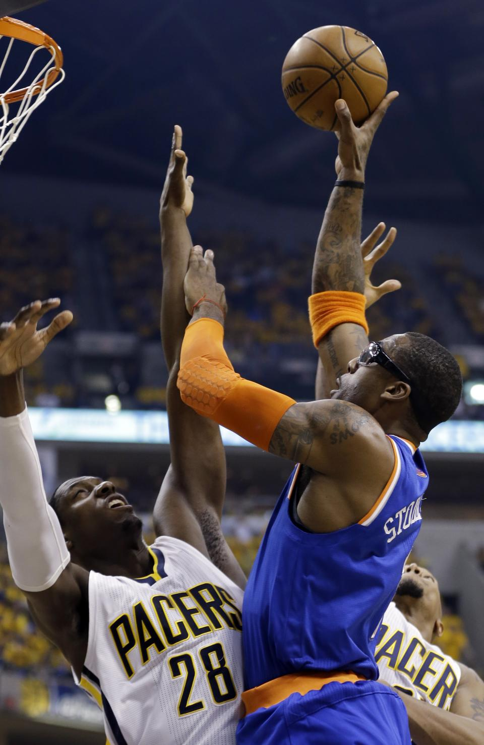 New York Knicks' Amare Stoudemire shoots over Indiana Pacers' Ian Mahinmi (28) during the first half of Game 6 of an Eastern Conference semifinal NBA basketball playoff series Saturday, May 18, 2013, in Indianapolis. (AP Photo/Darron Cummings)