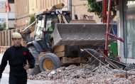A worker removes the rubble in Lorca, Spain, on Thursday, May 12, 2011. Two earthquakes shook southeastern Spain in quick succession Wednesday, killing people, injuring dozens and causing extensive damage to buildings. It was the largest number of earthquake-related deaths in Spain over 50 years.