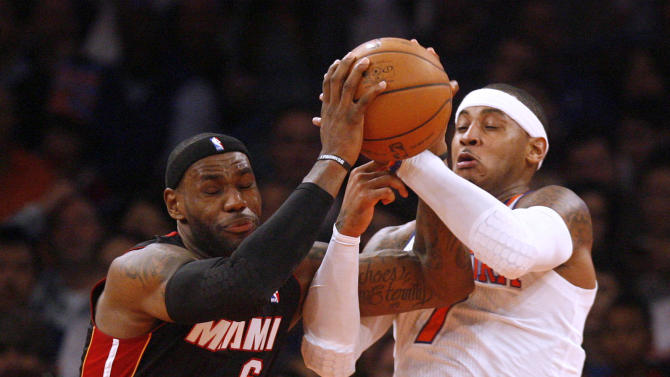 Miami Heat's LeBron James (6) tries to maintain possession while being defended by New York Knicks' Carmelo Anthony (7) during the first half of an NBA basketball game, Friday, Nov. 2, 2012, in New York. (AP Photo/Jason DeCrow)