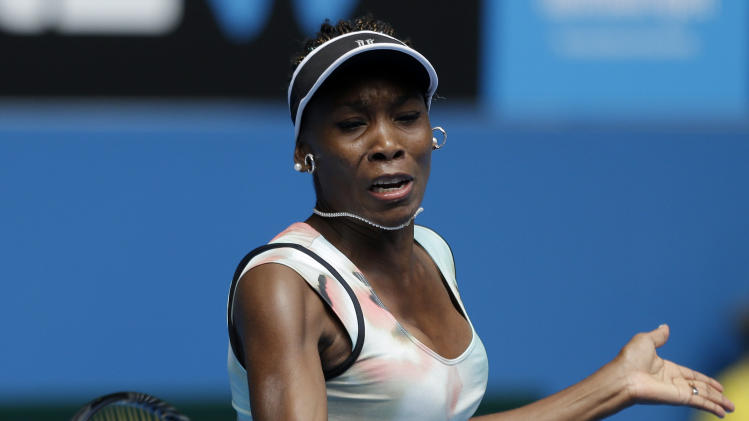 Venus Williams of the US makes a forehand return to Kazakstan's Galina Voskoboeva during their first round match at the Australian Open tennis championship in Melbourne, Australia, Monday, Jan. 14, 2013. (AP Photo/Rob Griffith)