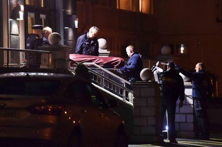 File photograph shows police as they remove a body from the scene of a shooting at the Regency Hotel in Dublin, Ireland