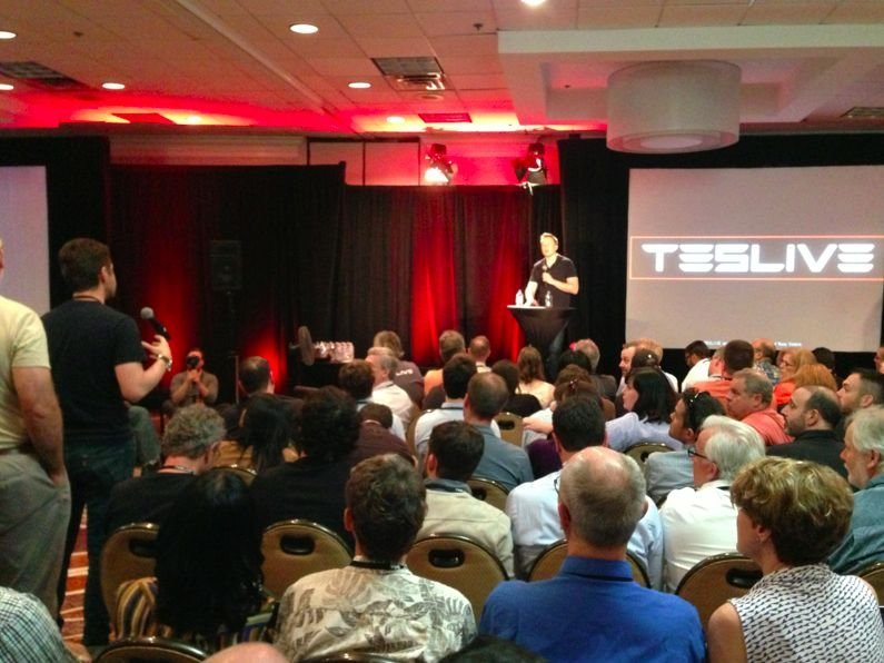 Cole Wilcox talking to Elon Musk at Teslive