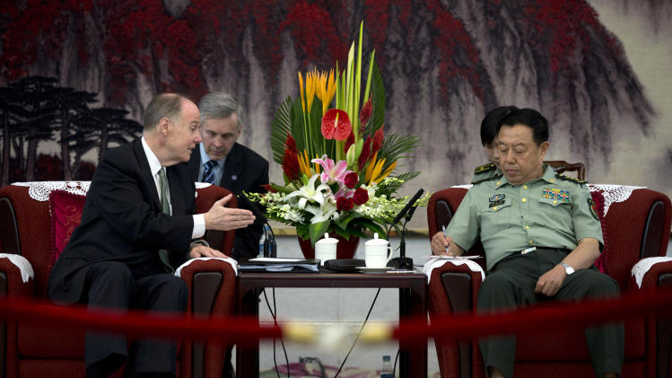 U.S. National Security Adviser Tom Donilon, left, talks with Gen. Fan Changlong, right, vice chairman of China's Central Military Commission, during their meeting at the Bayi Building, headquarters of Chinese Defense Ministry, in Beijing Tuesday, May 28, 2013. (AP Photo/Alexander F. Yuan, Pool)