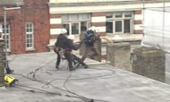G8 Protests: Man Tries To Jump Off Building