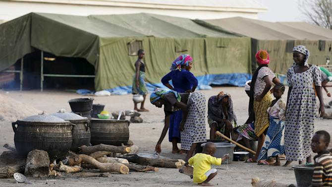 Women are seen preparing dinner at the Malkohi camp for internally displaced people in Yola
