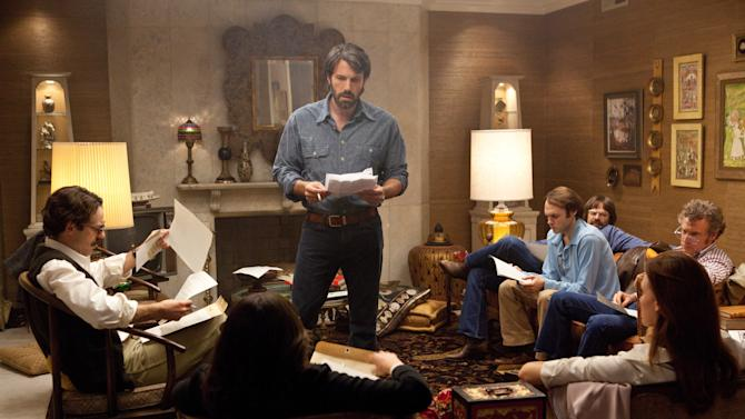 """This film image released by Warner Bros. Pictures shows Ben Affleck as Tony Mendez, center, in """"Argo,""""  a rescue thriller about the 1979 Iranian hostage crisis. On Thursday, Dec. 13, 2013, Affleck was nominated for a Golden Globe for best director and """"Argo"""" received a nomination for best film.  The 70th annual Golden Globe Awards will be held on Jan. 13.  (AP Photo/Warner Bros., Claire Folger)"""