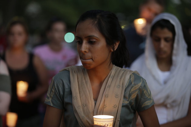 Mourners take part in a candle light vigil for the victims of the Sikh Temple of Wisconsin shooting, in Milwaukee, Sunday, Aug 5, 2012. An unidentified gunman killed six people at a Sikh temple in sub