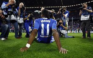 Photographers take pictures of Chelsea's Drogba after their Champions League final soccer match against Bayern Munich at the Allianz Arena in Munich