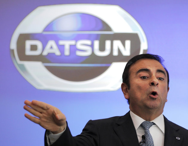 "FILE - In this March 21, 2012 file, Nissan Motor Co. Chief Executive Carlos Ghosn speaks during a news conference on the company's brand ""Datsun"" at its head office in Yokohama, near Tokyo. Ghosn said"