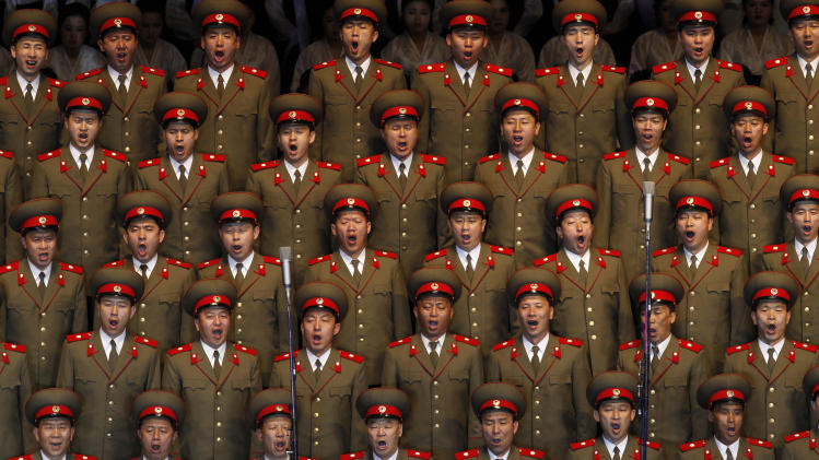In this April 16, 2012 photo, North Korean soldiers sing at the Pyongyang indoor gymnasium to commemorate late president Kim Il Sung's 100th birthday in Pyongyang, North Korea.  The spectacles exist at a North Korean intersection of dogma, tedium and entertainment.  (AP Photo/Vincent Yu)