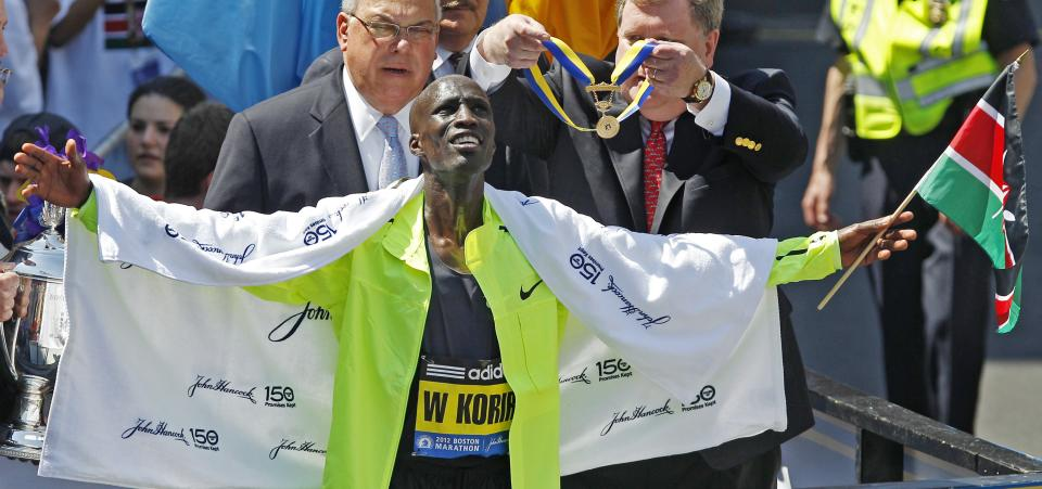 Wesley Korir, of Kenya, celebrates after winning the 116th Boston Marathon in Boston, Monday, April 16, 2012. (AP Photo/Charles Krupa)