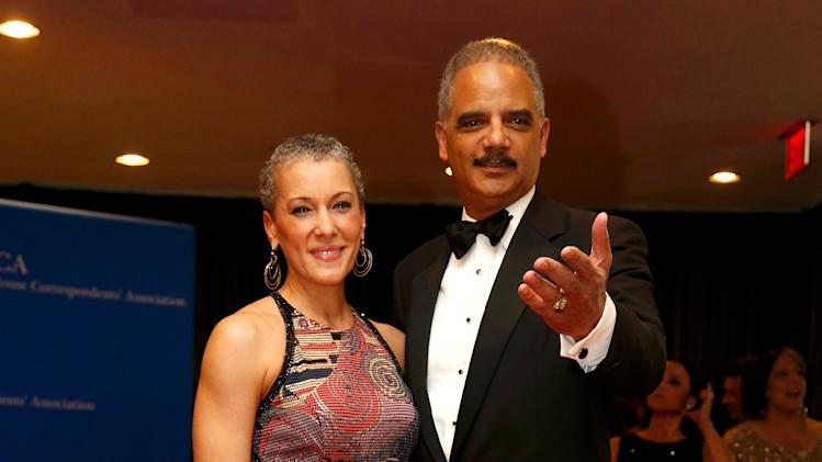 Attorney general eric holder and dr sharon malone arrive at the white