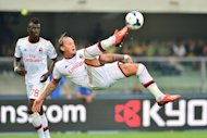 AC Milan's French defender Philippe Mexes controls the ball during the Serie A match against Hellas Verona at Bentegodi Stadium in Verona on August 24, 2013