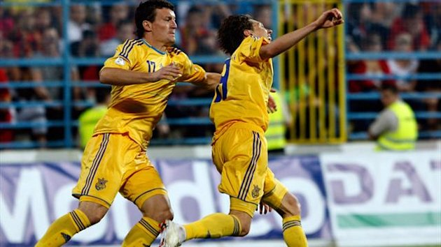 Ukraine's Denis Garmash (R) celebrates his goal with teammate Artem Fedetskyy during their World Cup qualifying soccer match against Montenegro in Podgorica June 7, 2013. REUTERS