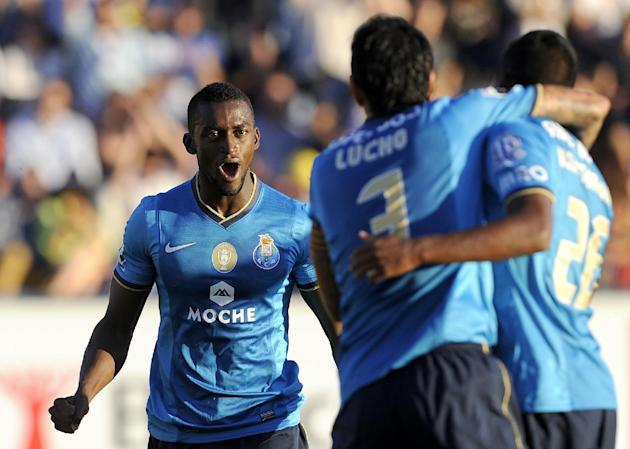 FC Porto's Jackson Martinez, left, celebrates after scoring the opening goal against Arouca during their Portuguese League soccer match at the Municipal Stadium, in Arouca, Portugal, Sunday Oct. 6, 20