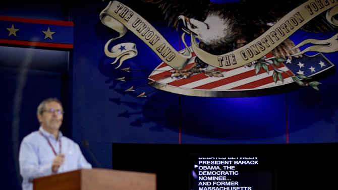 A TelePrompTer appears from behind the stage during a rehearsal for a presidential debate, Tuesday, Oct. 2, 2012, at the University of Denver in Denver. President Barack Obama and Republican presidential candidate and former Massachusetts Gov. Mitt Romney will hold their first debate Wednesday. (AP Photo/David Goldman)