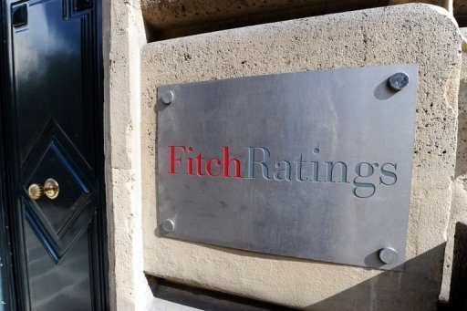 "<p>A picture shows the entrance of Fitch ratings agency in Paris. The credit ratings agency Fitch downgraded on Wednesday debt issued by eurozone member Cyprus by two notches, from ""BB+"" to ""BB-"" and said the outlook was negative, which means it could be cut further.</p>"