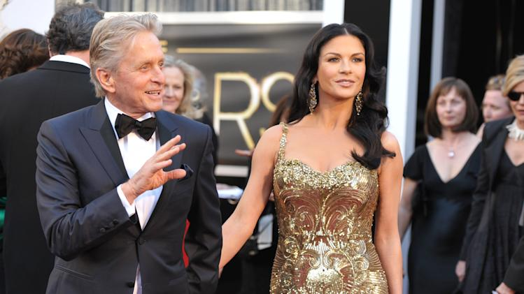 Actors Michael Douglas, left, and Catherine Zeta-Jones arrives at the Oscars at the Dolby Theatre on Sunday Feb. 24, 2013, in Los Angeles. (Photo by John Shearer/Invision/AP)