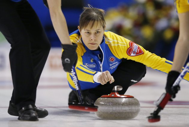 Alberta skip Moore throws a rock against Saskatchewan during Scotties Tournament of Hearts curling championship in Kingston