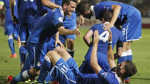 Manolo Gabbiadini of Italy lies on the ground as he celebrates his goal against Israel during their European Under- 21 Championship soccer match at Blumfield stadium in Tel Aviv June 8, 2013. (Reuters)