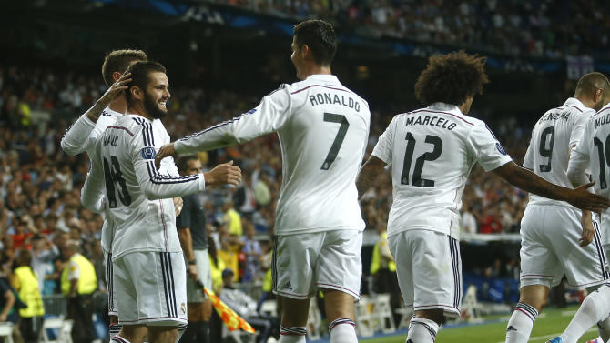 Real Madrid players celebrate after Basel's Marek Suchy scored an own goal to open the scoring during the Champions League Group B soccer match between Real Madrid and Basel at the Santiago Bernabeu stadium in Madrid, Spain, Tuesday Sept. 16, 2014. (AP Photo/Andres Kudacki)